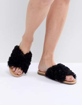 UGG Joni Black Shaggy Cross Strap Slides