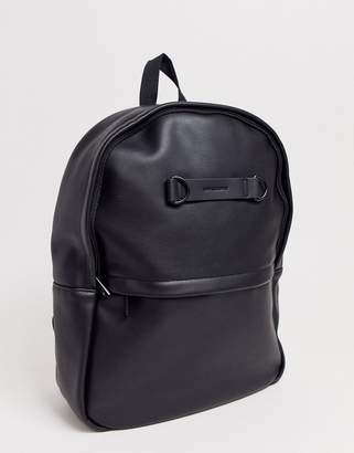 Asos Design DESIGN faux leather backpack in black with d-ring logo detail