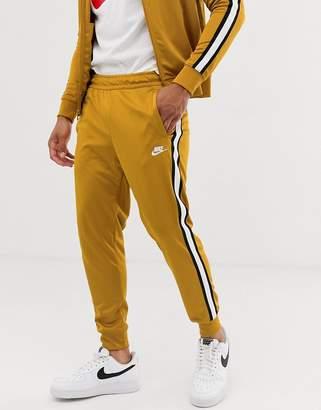 Nike Tribute Logo Sweatpants Gold