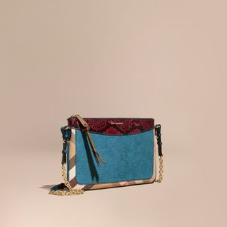 Burberry Leather, House Check and Snakeskin Clutch Bag $795 thestylecure.com