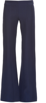 DEREK LAM Mid-rise flared wool and silk-blend trousers $1,210 thestylecure.com