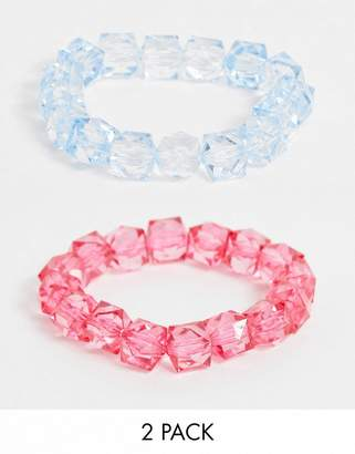 Asos Design DESIGN pack of 2 stretch bracelets with baby blue and hot pink plastic beads