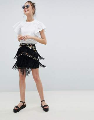 Asos DESIGN floral embroidery mini skirt with fringe detail