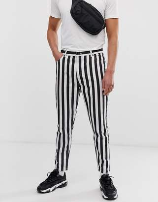 Bershka striped carrot fit jeans in black and white