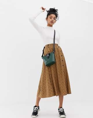 Asos DESIGN leopard print midi skirt with double placket button detail