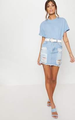 PrettyLittleThing Light Wash Heavy Distressed Denim Mini Skirt