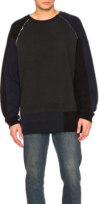 Maison Margiela Patchwork Sweatshirt $725 thestylecure.com