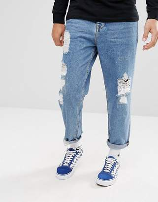Asos DESIGN Skater Jeans In Vintage Mid Wash Blue With Heavy Rips