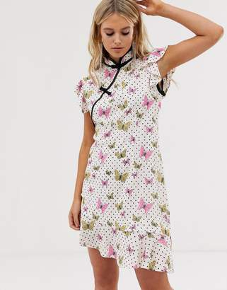 Sister Jane mini dress with peplum hem and frogging in butterfly spot