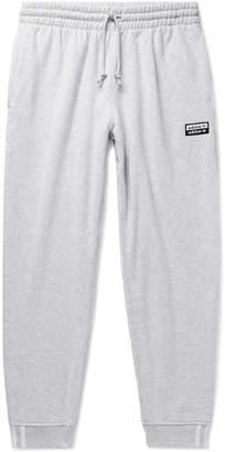 adidas R.y.v. Tapered Logo-Appliqued Melange Loopback Cotton-Jersey Sweatpants