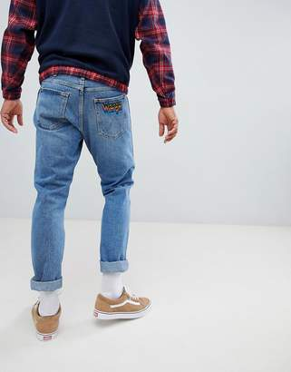 Wrangler Slider Tapered Jeans with Rainbow Patch Kabel Blue