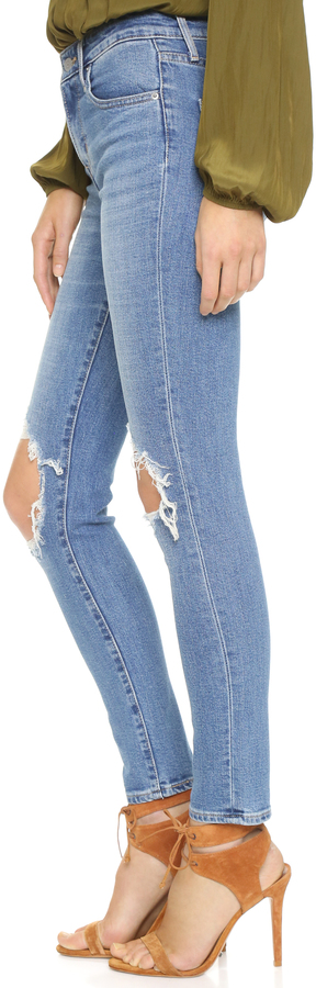 Levi's 721 High Rise Distressed Skinny Jeans 4