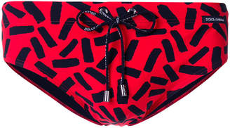 Dolce & Gabbana tape print swimming trunks