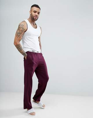 Asos Straight Leg Jersey Pajama Bottom With Branded Waistband In Burgundy