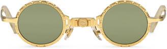 Round-frame metal sunglasses $690 thestylecure.com