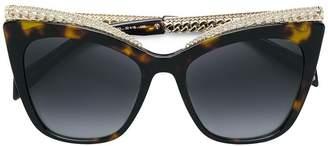 at Farfetch Moschino tortoiseshell curb chain trim sunglasses