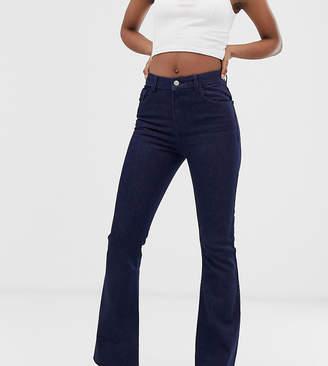 Reclaimed Vintage The '99 flare jean in dark indigo wash