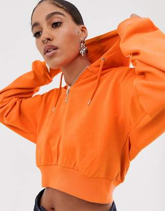 Asos Design DESIGN cropped hoodie with half zip in orange