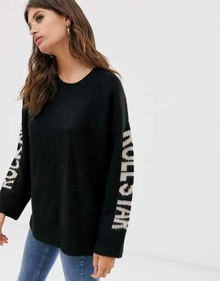 Religion oversized sweater with rock and roll slogan