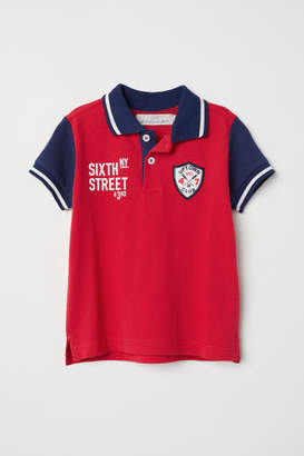 H&M Polo shirt with appliques - Red