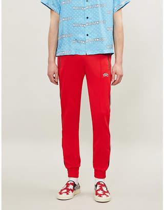 a7f28ec181d53c Amiri Logo-tape cotton-jersey jogging bottoms