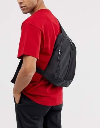 Asos Design DESIGN cross body backpack in black with front mesh pocket