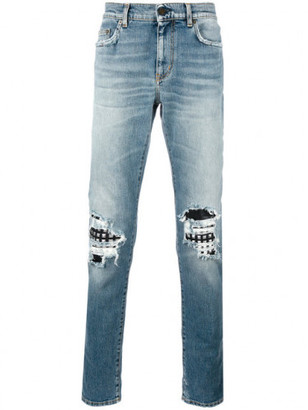 Saint Laurent hole leath jeans $1,190 thestylecure.com