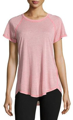 The North Face Nueva Short-Sleeve Training T-Shirt, Calypso Coral $40 thestylecure.com