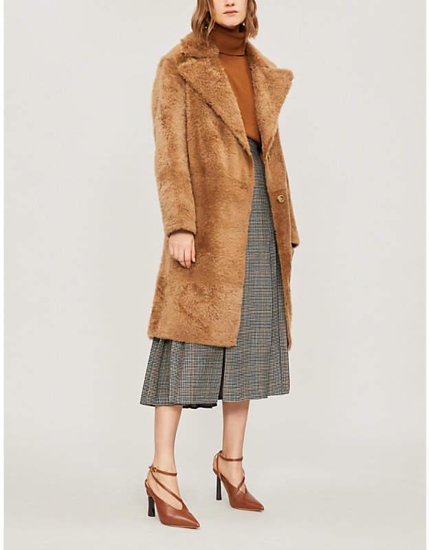 Knee-length shearling coat
