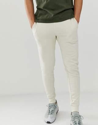 Asos Design DESIGN skinny sweatpants in off white