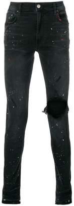 Amiri paint splatter skinny jeans
