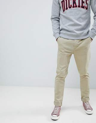 Asos DESIGN tapered chinos in vintage washed stone with turn up