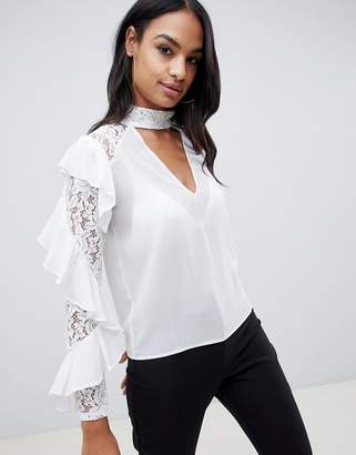 TFNC lace ruffle sleeve top with cut out detail