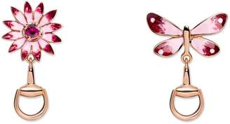 Gucci Flora earrings in rose gold, enamel and rubies
