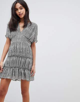 Asos DESIGN soft mini dress with tiers in animal print