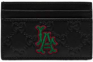 Gucci black embossed LA patch leather cardholder