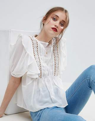 ASOS Ruffle Blouse with Eyelet Detail and Lace Insert $54 thestylecure.com