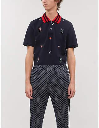 ece12867ee57 Gucci Multi-logo embroidered cotton-piqué polo shirt