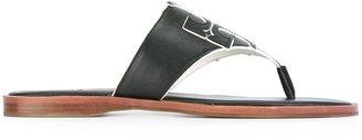 Tory Burch logo flat sandals $187.67 thestylecure.com