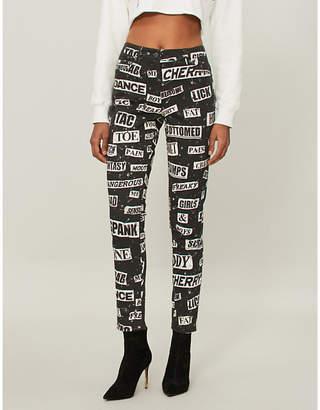 Moschino Slogan-print skinny mid-rise jeans