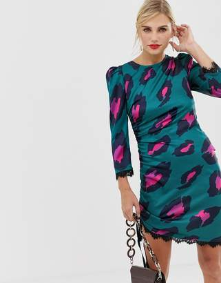 Liquorish shift dress in satin bright leopard print with lace trim and ruched side