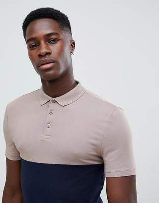 Asos Design DESIGN muscle fit polo shirt with contrast yoke in navy