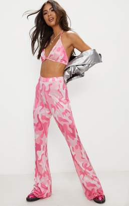 PrettyLittleThing Pink Camo Print Slinky Flared Trousers
