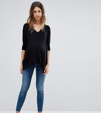Asos DESIGN Maternity Tall Ridley high waist skinny jeans in neo bright blue wash with under the bump waistband