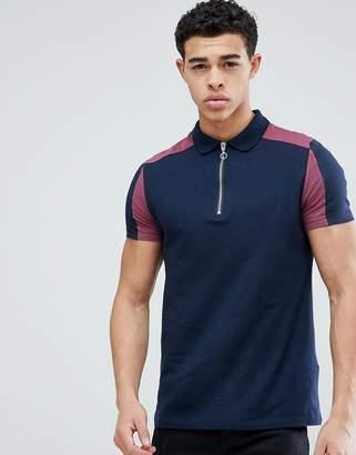 Asos DESIGN zip neck polo shirt with color block in navy