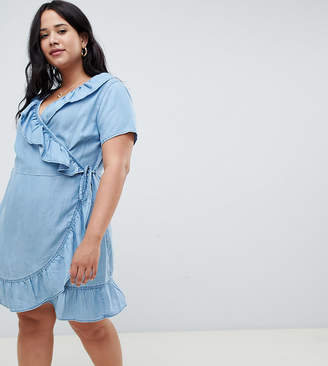 Asos DESIGN Curve denim wrap dress with frill detail in midwash blue