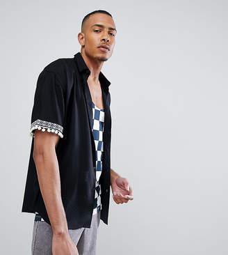 Asos DESIGN Tall festival oversized shirt with pom pom & geo-tribal detail sleeve