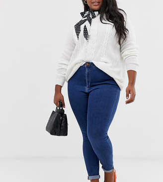 Asos DESIGN Curve Ridley high waisted skinny jeans in rich mid blue wash