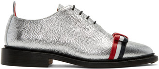 Thom Browne Silver Wholecut Bow Oxfords $1,050 thestylecure.com