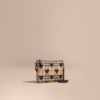 Burberry Heart Print Check and Leather Clutch Bag $650 thestylecure.com